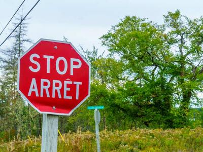 Stop sign in French and English