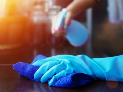 hand wearing gloves cleaning